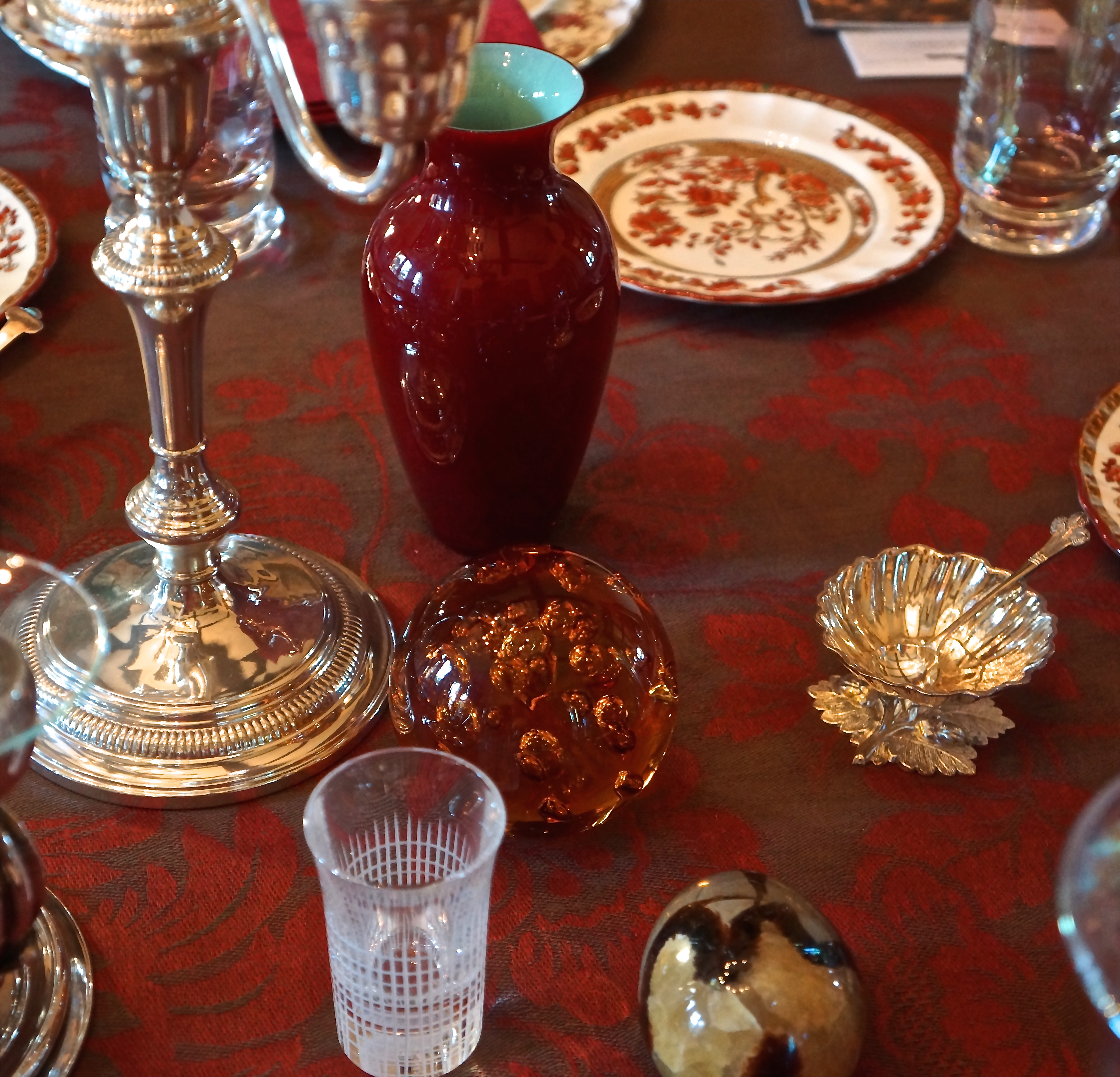 I included whimsical things from my collection: A blue Lalique butterfly, an amethyst geode, a blood red Chinese vase and porcelain cherub bowls to hold the cranberries were all part of the mix.