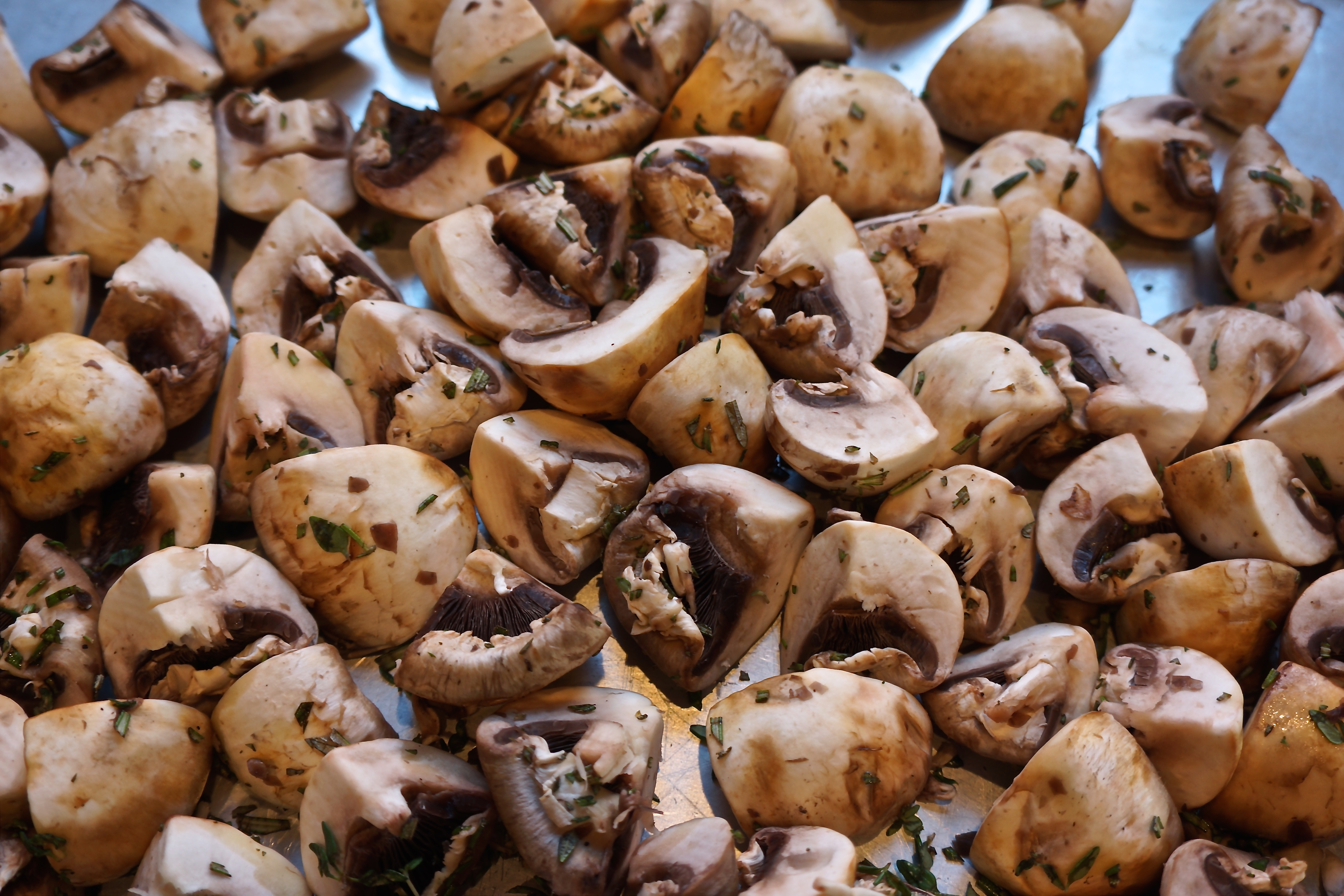 Cut the mushrooms into halves or quarters, depending on the size of the mushrooms.